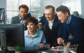 A group of colleagues comparing IAM software at the office.